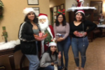 Students pose with santa